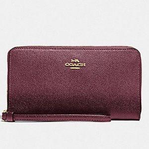 COACH Large Metallic Wine Leather Phone Wristlet Wallet